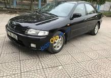 Cần bán Mazda 323 đời 1999, màu đen số sàn, 130tr