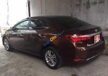 Cần bán xe Toyota Corolla altis 1.8G AT đời 2015, màu nâu chính chủ, 675 triệu