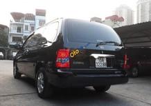 Cần bán gấp Kia Carnival GS 2.5 AT năm 2009, màu đen số tự động, 315 triệu
