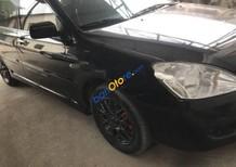 Cần bán xe Ford Laser Ghia 1.8 AT đời 2004, màu đen xe gia đình, giá chỉ 230 triệu