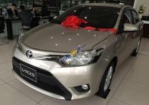 Cần bán Toyota Vios 1.5E 2018, màu ghi vàng