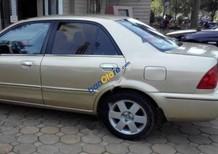 Bán ô tô Ford Laser sản xuất 2003, màu vàng