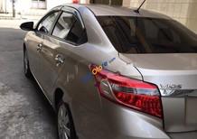 Cần bán gấp Toyota Vios đời 2016, màu ghi vàng