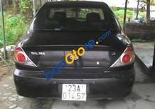 Cần bán Kia Spectra đời 2005, màu đen