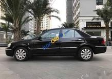 Bán Ford Laser Deluxe AT đời 2006, màu đen xe gia đình, giá 265tr