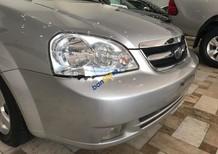 Cần bán gấp Daewoo Lacetti đời 2011, màu bạc số sàn