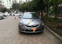 Cần bán Honda Civic 1.8AT đời 2010, màu bạc