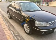 Gia đình bán Ford Laser 1.8 GHIA đời 2004, màu đen