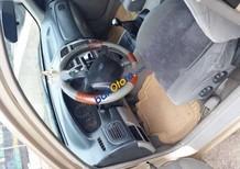 Bán ô tô Ford Laser Delu 1.6 MT sản xuất năm 2002, màu vàng