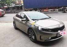 Bán xe Kia Cerato năm sản xuất 2016, màu vàng