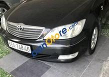 Bán xe Toyota Camry 2.4G sản xuất năm 2002, màu đen số sàn, 340 triệu