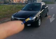 Cần bán xe Mazda 323 năm 2003, màu đen chính chủ, 170 triệu