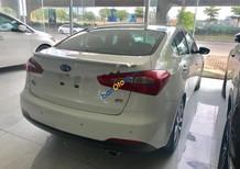 Bán xe Kia K3 2.0 sản xuất năm 2014, màu trắng, nhập khẩu, còn cực mới