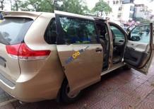 Cần bán xe Toyota Sienna LE 2.7 sản xuất năm 2010, màu vàng, nhập khẩu