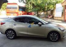 Cần bán gấp Mazda 2 1.5AT sản xuất 2015, màu vàng như mới