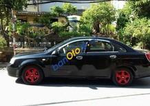 Cần bán gấp Daewoo Lacetti năm 2004, màu đen như mới