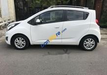 Bán ô tô Chevrolet Spark LT đời 2013, màu trắng xe gia đình, chạy được 36,800 km