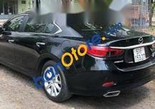 Bán Mazda 6 năm sản xuất 2015, màu đen còn mới, giá tốt