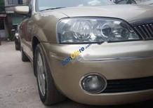 Bán Ford Laser 2002, màu vàng