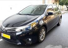 Cần bán lại xe Toyota Corolla altis 1.8G AT đời 2016, màu đen xe gia đình, giá tốt