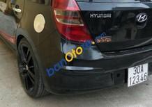 Xe Hyundai i30 1.6 AT sản xuất 2010, màu đen xe gia đình