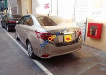 Bán ô tô Toyota Vios sản xuất năm 2015, màu vàng cát