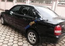 Bán xe Mazda 323 năm 2011, màu đen, nội thất còn đẹp zin