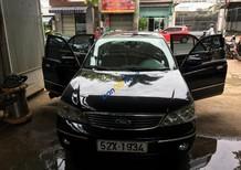 Cần bán Ford Laser Ghia AT năm 2004, màu đen xe gia đình