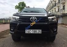 Cần bán Toyota Hilux 3.0 4*4 AT năm 2016, màu đen