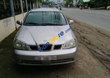 Cần bán lại xe Daewoo Lacetti MT sản xuất 2004, màu bạc
