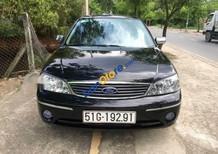 Bán Ford Laser năm sản xuất 2004, màu đen xe gia đình