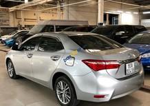 Cần bán xe Toyota Corolla altis 1.8AT sản xuất năm 2016, màu bạc số sàn