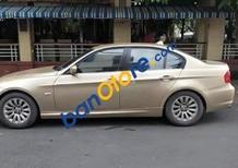 Cần bán xe BMW 3 Series 320i năm sản xuất 2009, màu vàng xe gia đình