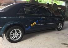 Cần bán lại xe Ford Laser 1.6 năm 2005, màu đen, 220 triệu