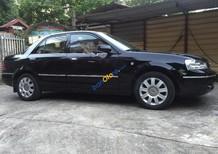 Cần bán gấp Ford Laser 1.8 AT sản xuất 2005, màu đen, giá 245tr