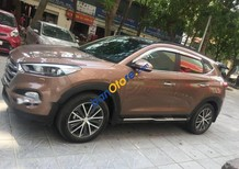 Cần bán xe Hyundai Tucson năm sản xuất 2016, màu nâu