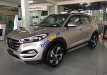 Cần bán Hyundai Tucson năm sản xuất 2018, màu vàng, giá 903.9tr