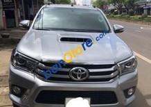 Bán ô tô Toyota Hilux G sản xuất năm 2015, màu bạc còn mới