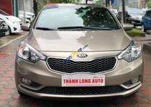 Cần bán xe Kia K3 1.6AT sản xuất 2014, màu vàng