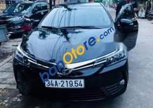 Cần bán lại xe Toyota Corolla Altis 1.8E AT năm 2017, màu đen số tự động, giá 720tr