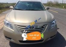 Cần bán xe Toyota Camry LE năm sản xuất 2007, màu vàng, nhập khẩu