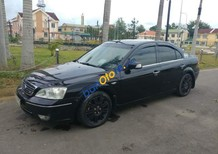 Cần bán lại xe cũ Ford Mondeo sản xuất năm 2004, màu đen, xe gia đình