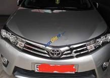 Chính chủ bán ô tô cũ Toyota Corolla Altis 1.8G AT đời 2014, màu bạc
