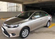 Cần bán gấp xây nhà xe Toyota Vios đời 2016, số tự động màu vàng cát