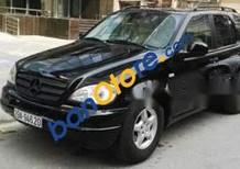 Bán Mercedes ML320 năm sản xuất 2002, màu đen, nhập khẩu nguyên chiếc chính chủ, giá chỉ 255 triệu