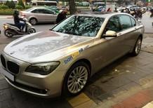 Xe BMW 7 Series 750li sản xuất năm 2011, màu vàng, nhập khẩu như mới
