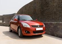 Cần bán gấp xe Suzuki Swift 2016, số tự động màu cam đỏ, xe zin cọp