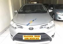 Bán Toyota Vios 1.5E năm 2015, màu bạc
