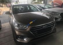 Cần bán Hyundai Accent sản xuất năm 2019, màu vàng