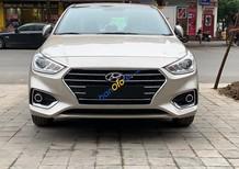 Bán xe Hyundai Accent 1.4 AT sản xuất năm 2019, màu kem (be)